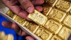 Spot gold was 0.1 percent higher at $1,296.91 per ounce by 0124 GMT.  Gold prices edged higher on Thursday, supported by a weaker Dollar amid ongoing concerns about a trade war between the United States and its allies.
