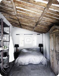 Gray color scheme. I love the combination of antiques and the old industrial shelving!