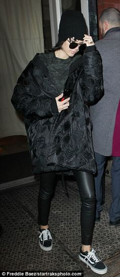 Kopy-Kat! The 21-year-old supermodel wore a very similar outfit as Kim, 36, in black puffer coat which she draped around her shoulders one day after her sister did