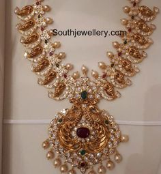 Peacock mango design antique gold medium length nakshi haram studded with rubies,emeralds, cz stones and pearls by sri mahalakshmi gems and jewellers.For details please reach out - sri mahalakshmi gems and jewellers. Indian Wedding Jewelry, Indian Jewelry, Bridal Jewelry, Indian Bridal, Indian Necklace, Ruby Jewelry, Chain Jewelry, Bridal Accessories, Jewelry Sets