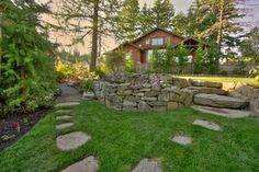 stepping stones in the lawn retaining wall natural look