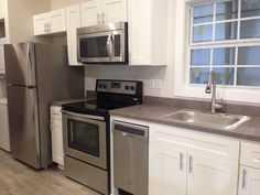 Spacious kitchen with White Shaker Cabinets and a dishwasher!