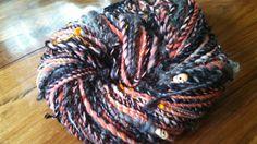 "One of my seasonal yarns,""HalloweenTown"" with plied merino, Lincoln locks, mohair, silk, and small skully beads..."