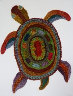 Crochet turtle - art by Ann Benoot a self taught textile designer from Belgium. Read and interview with her here: http://www.crochetconcupiscence.com/2015/06/interview-with-crochet-artist-ann-benoot/