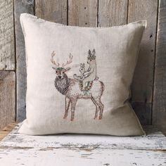 These two bunnies sit atop an elk, all are decorated for a festive adventure together. Pair with Scouter and Sentinel pillows. Pillow has a small feather, down insert. Embroidered cover on 100 Embroidery Art, Cross Stitch Embroidery, Embroidery Patterns, Machine Embroidery, Textiles, Cross Stitching, Textile Art, Fiber Art, Needlework