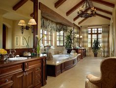 What an unreal bathroom! Love how the tub surround matches the vanity. The big mirror is perfect. It might be a little bit small for me though... Not.