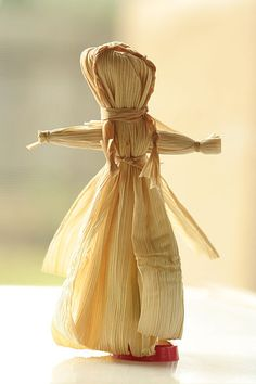 A traditional Native American corn husk doll