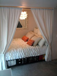"neat idea to divide a bedroom between two sisters to make it ""private""!"