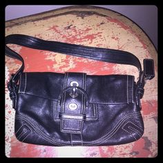 Coach Shoulder Bag Black leather Coach purse with silver buckle detail and magnetic front closure. In excellent condition. Coach Bags Shoulder Bags
