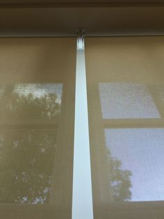 Sunscreen roller blinds | Detail showing how we installed the blinds side by side and reverse roll | Fitted to living room French doors in Haywards Heath, Sussex | Made to measure | Modern blinds | Made in UK | Window treatment | Modern blinds | Electric blinds