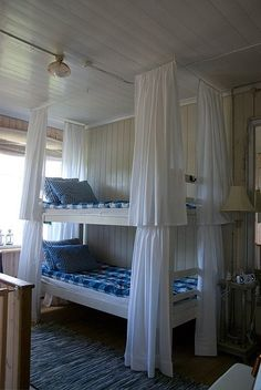 Love the curtains around each bunk bed. Gives each person the option of privacy.