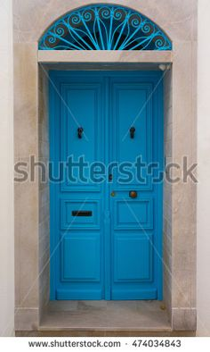Blue wooden door with arch from Sidi Bou Said in Tunisia