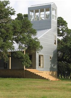 Corrugated metal farmhouse by Mell Lawrence Architects.  This house is in Round Top across the road from my sister's house.