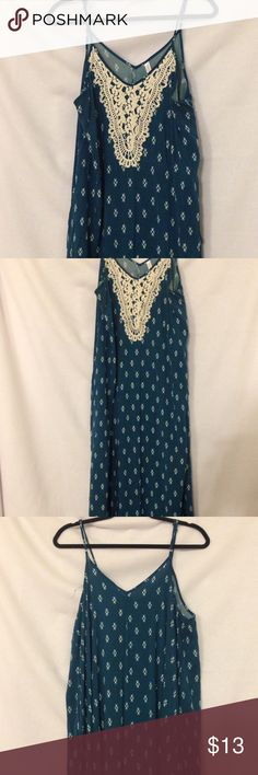 Blue patterned boho maxi dress Long blue boho style maxi dress. It has pockets! Cute lace appliqué at the top. Plain long maxi with small white pattern. Worn once to an outdoor wedding. Some minor wear in the seams at the bottom from stepping on it. Xhilaration Dresses Maxi