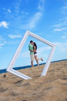 What a fun idea for an engagement photo shoot at the Jersey shore...   This is sooo cool!