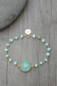 This listing is for the bracelet with round Aqua Chalcedony stone only, shown on its own in the 1st picture. Other items shown on the model are available separately in my shop. ..............................................................................................................