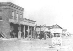 """A view looking east on front street in Dodge City, circa The signs admonish you to check your guns and drink """"Prickly Ash Bitters""""! from an Interesting History of Dodge City Dodge City Kansas, Kansas City, Old Western Towns, Western Homes, Western Art, Old West Outlaws, Old West Town, Old West Photos, West Road"""