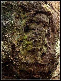 Alderley Edge, Cheshire, England has been a sacred site for thousands of years and has many legends attached to it. A natural spring is situated in the wood below the sandstone cliff which is carved with a bearded face.