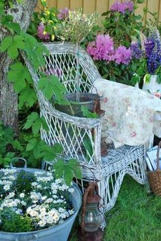 Love this old wicker chair in the garden.