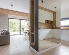 Projekt domu w okolicach Poznania ok. 120 m2 - Duża otwarta kuchnia w kształcie litery g z oknem, styl nowoczesny - zdjęcie od Architektownia