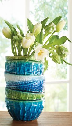 Optical illusion alert: the Stacked Bowl Vase is a single vase that's cleverly shaped and playfully painted to look like a tippy stack of colorful bowls. What's more fun than this? A quick way to add charm to a bookshelf, mantel, or even kitchen shelving.