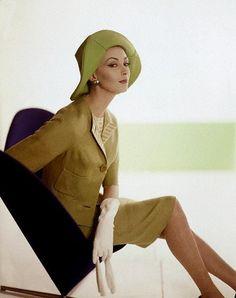 Wilhelmina wearing a lime green suit of rayon & silk by David Crystal, hat by Mr. John, gloves by Kislav, earrings by Vendome, 1962.