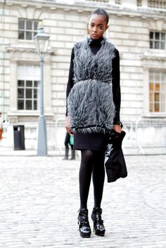 Look at this furry grey gilet on top of a black roll neck and skinny pencil skirt. We like!