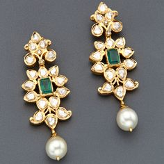Gorgeous Kundan jewellery with green stone embellishments and south sea pearl drop.  Find more at www.jivaana.com