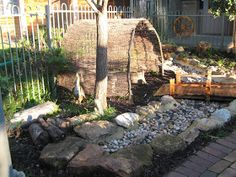 let the children play: Simple Play Space Transformations: #2 Shelters. Hessian or rattan fencing and bridge over pebble stream. <3