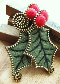 Holly and berries brooch of zippers and felt.