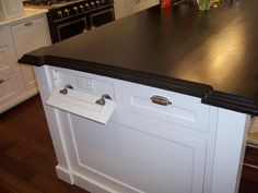 Kitchen island with outlets disguised as drawers via Houzz