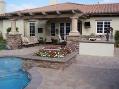 backyard retreat includes covered patio and stone planters Pool Porch, Pool Backyard, Backyard Ideas, Stone Planters, Outdoor Stone, Outdoor Speakers, Built In Grill, Pergola With Roof, Backyard Retreat