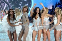 Models Lily Aldridge, Karlie Kloss, Adriana Lima, Doutzen Kroes and Candice Swanepoel walk the runway at the 2013 Victoria's Secret Fashion Show at Lexington Avenue Armory on November 13, 2013 in New York City.