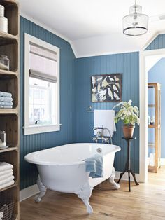 Blue is a calming color, which might be why it's a common hue for bathrooms. The walls of this blue bathroom (which happens to be from our 2010 eco-friendly House of the Year!) are Benjamin Moore Natura in Fiji.
