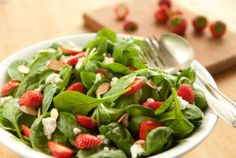 Spinach and Strawberry Salad | Whole Foods Market: 1/2 shallot, finely chopped  2 tablespoons raspberry vinegar  2 tablespoons extra virgin olive oil  1/2 pound baby spinach  1 cup strawberries, thinly sliced  1/3 cup sliced almonds, toasted  2 ounces fresh goat cheese, crumbled