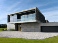 Architecture. Modern House With Cement And Stone Wall Design Plus Glass Railings In Balcony And White Gravel Plus Lawn Garden The Stunningly Mesmerizing Villa Řitka Designed by Studio Pha ~ Haybert
