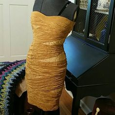 REDUCED! Cute gold/amber strapless dress Fun for an evening out.  Body hugging polyester, spandex. Gold with roushing wrap look. Small place on the side where a bit of over fabric is missing. See 4th picture. Dresses Strapless