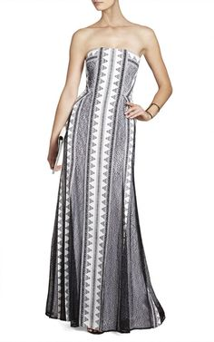 The exquisite blocked prints of this sleek gown will keep all eyes on you and your unmatched sense of style. Straight neck. Strapless. Allover blocked prints. Seamed waistline. Pleated, A-line skirt. Concealed center back zipper with hook-and-eye closure.