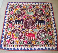 Antique folk art embroidered textiles from Gujarat, India. About 75 to 90 years old.  Check out http://ThreadsOfOld.etsy.com for more details and pricing.