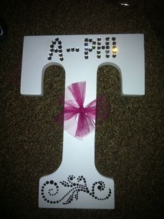 Your little's initial with your sorority name on it, plus sparkles and a bow. Love!