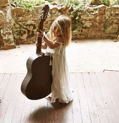 So cute!!! One day I'll take a picture of my little girls and or boys like this, taking the guitar to their daddy. :)