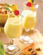 Ingredients        2 cups (16 oz.) Vanilla Almond Breeze® Almondmilk      1/2 ulz.) Rum, optional      1 (10 oz.) can frozen piña colada mix      1 cup fresh pineapple chunks, chilled      1 cup frozen, unsweetened mango chunks, partially thawed      Directions    Blend Almond Breeze with rum, piña colada mix (do not defrost) and pineapple chunks until smooth. Add mango; blend until smooth. Garnish with additional pineapple, if desired.