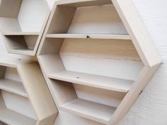 Hexagonal storage with shelves.