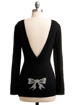 I love the back of this sweater!  My next knit project?  Would be easy to add the intarsia bow to an existing pattern.