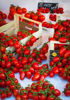 """Fresh Italian tomatoes at the market in old town Nice, France. This market is called """"Marche aux Fleur"""" or """"Cours Saleya""""."""
