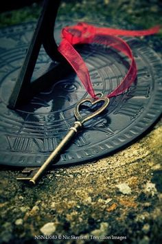 Trevillion Images - key-with-ribbon-on-sundial Under Lock And Key, Key Lock, Antique Keys, Vintage Keys, Valintines Day, Image Key, Door Knobs And Knockers, Old Keys, Romantic Images