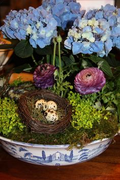 Featuring Julisk's 'Country Estate' Serving Bowl, in Delft Blue -- Think outside the Pot! Beautiful potted arrangements can be done in practically anything. Our Country Estate delft blue serving bowl hosts this gorgeous Spring centerpiece arrangement, perfect for an Easter display!