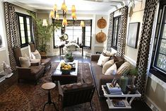 TriciaO: Brown Design - Imperial trellis curtains, leather chairs, sofa, leather bench ottoman ...
