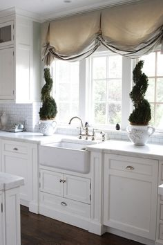 Mariposa Home .gorgeous cabinetry , valance & topiary's .