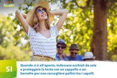 Indossa occhiali da sole e proteggi la testa con un cappello.